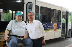 PACE participant and PACE worker using McGregor PACE Bus Transportation Service.